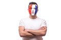 France football fan confident without emotion with  crossed hands of France national football team  on white background. Royalty Free Stock Photo