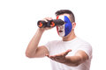 France football fan look at game of France national football team over binoculars Royalty Free Stock Photo