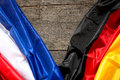France and Germany Flag on a wooden Background Royalty Free Stock Photo
