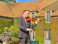 France violinist jérémie levi samson here gives a goodwill concert at a friends wedding the venue is the garden of chateau de Royalty Free Stock Photo