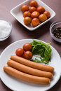Frankfurter sausages three on a white plate Stock Photo