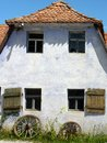 Frankonian farmhouse medieval with windows schutters wagon wheels g and rass blue sky Royalty Free Stock Images