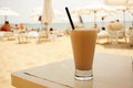 Frappe coffee cold white served with straw on table Royalty Free Stock Photo