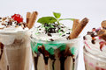 Frappe coffee with different flavours chocolate sticks and raspberries Royalty Free Stock Photo