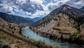 The fraser river as it winds its way through the fraser canyon to pacific ocean rail ways are running on both sides of Royalty Free Stock Photography