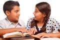 Fratello e sorella ispani svegli having fun studying Immagine Stock
