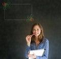Frau student oder lehrer mit dem stift und auflage weihnachtsstechpalmenmenü zum der checkliste zu tun Lizenzfreie Stockfotografie