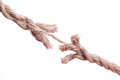 Frayed rope about to break isolated over a white background Royalty Free Stock Image