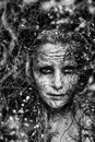 Freaky woman with face covered in clay staring at the camera Royalty Free Stock Images