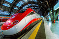 Frecciarossa on milan central station italy june trenitalia red arrow this high speed train can reach km h and operate turin Royalty Free Stock Photography