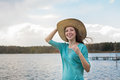 Freckled girl in hat smiling on the lake windy weather Stock Images
