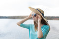 Freckled girl looking through glasses of lake in hat the Royalty Free Stock Photos