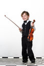 Freckled red hair boy playing violin isolated on white background Royalty Free Stock Images