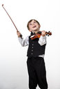 Freckled red hair boy playing violin isolated on white background Royalty Free Stock Photos
