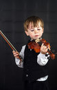 Freckled red hair boy playing violin young musician Stock Photo