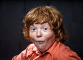 Freckled red hair boy posing on dark background emotions Royalty Free Stock Photo