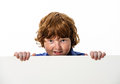 Freckled red hair boy showing to the white board isolated on white background Royalty Free Stock Images