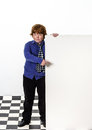 Freckled red hair boy showing to the white board isolated on white background Stock Photos
