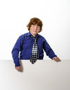 Freckled red hair boy showing to the white board on white background Royalty Free Stock Photo