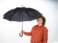 Freckled red hair boy with umbrella on white background Stock Photo