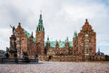 Frederiksborg Castle and Neptune Fountain in Hillerod Royalty Free Stock Photo