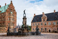 Frederiksborg Castle and Neptune Fountain Square Royalty Free Stock Photo