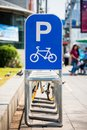 Free bicycle parking with sign in city Royalty Free Stock Photo