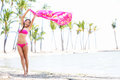 Free bikini vacation woman on paradise beach waving scarf sarong in wind happy in travel holiday in tropical hawaii an Stock Image
