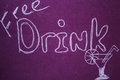 Free drink sign on violet chalkboard