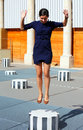 Free happy woman jumping on top of the column Stock Photo
