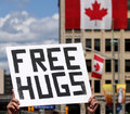 Free Hugs Sign on Canada Day Stock Photography