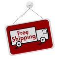 Free shipping sign that is red and hanging with a truck on it Royalty Free Stock Image