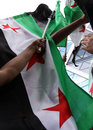 Free syria syrian flags waving hand protest hand raised Stock Photos