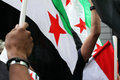 Free syria syrian flags waving hand protest hand raised Royalty Free Stock Photography