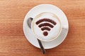 Free wifi area sign on a latte coffee Royalty Free Stock Photo