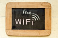 Free wifi symbol written on blackboard Stock Photo