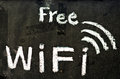 Free wifi symbol written on blackboard Stock Photography
