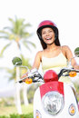 Free woman riding scooter happy Royalty Free Stock Image