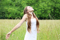 Free young woman on the meadow breathes in deeply Stock Photos