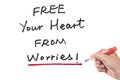 Free your heart from worries words written on white board Royalty Free Stock Photo