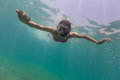 Freediver descends into blue water woman deep Royalty Free Stock Images