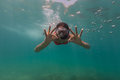 Freediver showing ok sign woman descends into water Royalty Free Stock Photography