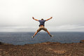 Freedom or adventure concept - jump of young man Royalty Free Stock Photo