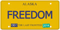 Freedom alaska license plate an imitation with december stickers and written on it making a great concept words on the bottom last Royalty Free Stock Images