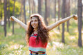 Freedom beautiful girl in a forest take a Stock Photo