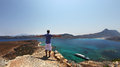 Freedom feeling of a man with arms open panoramic view from gramvousa crete greece over the sea and islands nearby combining Royalty Free Stock Photos