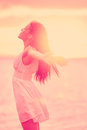 Freedom free happy serene woman enjoying sunset beautiful in dress embracing the golden sunshine glow of with arms Royalty Free Stock Images