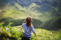 Freedom girl in mountains Royalty Free Stock Photo