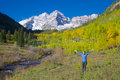 Freedom at maroon bells a woman with arms raised in and wonder the scenic aspen colorado in fall Royalty Free Stock Image