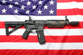 Freedom and protection the black rifle ar carbine the flag of usa Stock Photos
